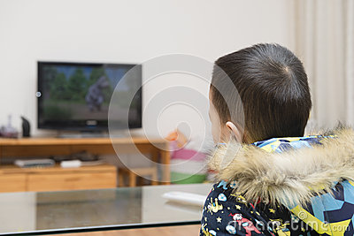 Boy watching cartoon TV Stock Photo