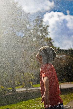 Boy in Water Fountain