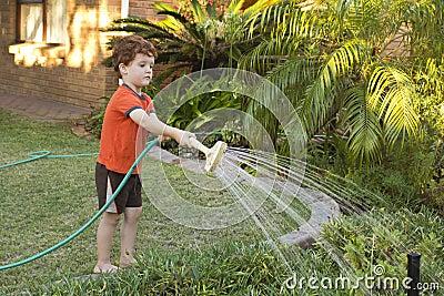 Boy watering the garden