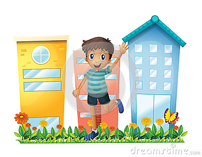 A boy waving in front of the high buildings