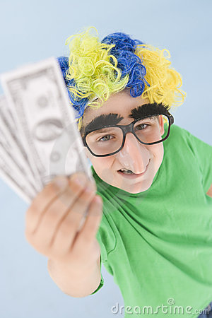 Boy wearing clown wig and fake nose holding money