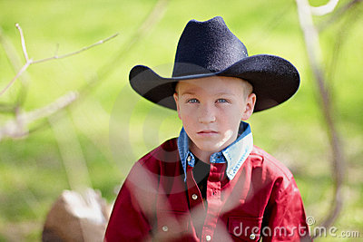 Boy wearing cowboy hat