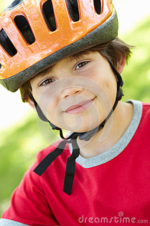 Boy wearing cycling helmet