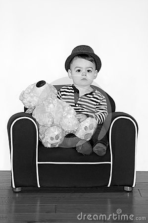 Free Boy Wearing Hat With Teddy Bear In Black And White Photography Royalty Free Stock Photos - 105012848