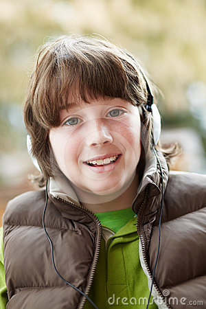Boy Wearing Headphones And Listening To Music