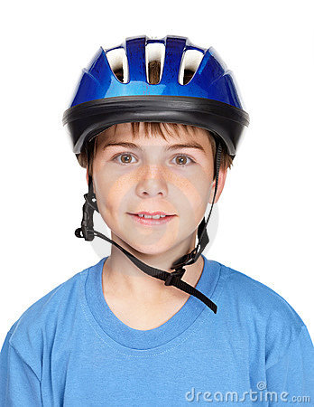 Boy wearing a protective helmet against white