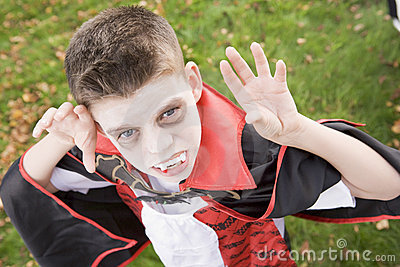 Boy wearing vampire costume on Halloween