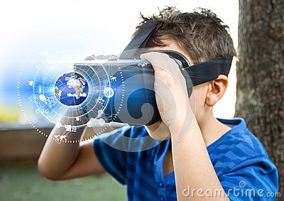 Boy wearing VR Virtual Reality Headset with Interface Stock Photo