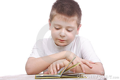 Boy in white shirt reading book