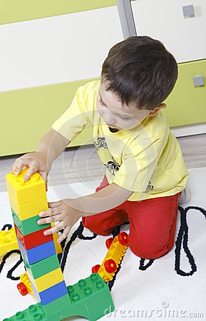 Boy who builds castles with plastic cubes