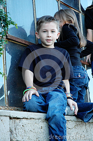 Boy on Window Ledge
