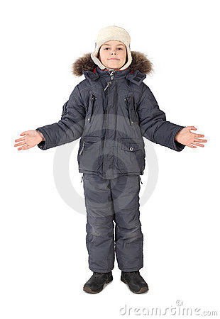 Boy in winter dress standing hands at sides