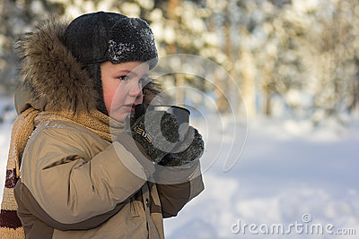 Boy in the winter wood