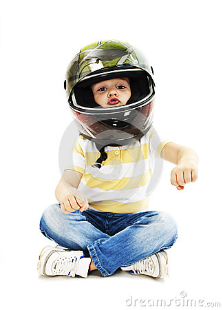 Free Boy With A Helmet, Pretending To Drive A Motorcycle Stock Photo - 45550440
