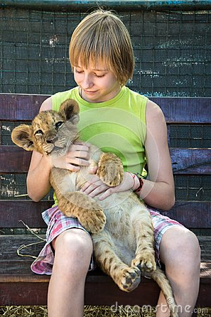 Free Boy With A Young Lion Royalty Free Stock Photography - 107016267