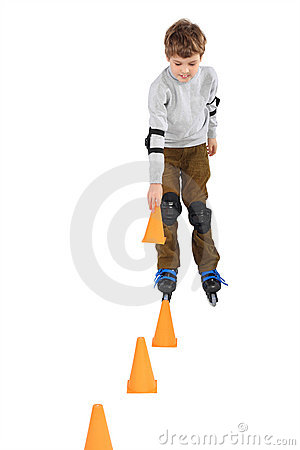 Free Boy With Cone In Hand Rollerblading Near Cones Stock Photography - 15656742