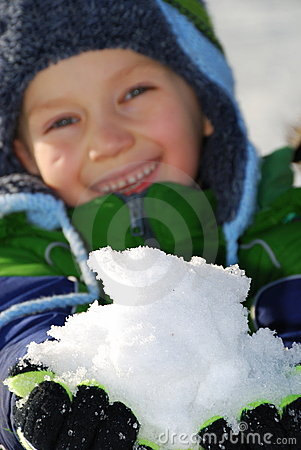 Free Boy With Handful Of Snow Stock Photo - 4071400