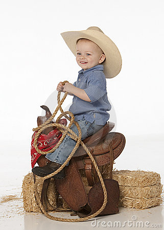Free Boy With Hat And Saddle Stock Photography - 9363882