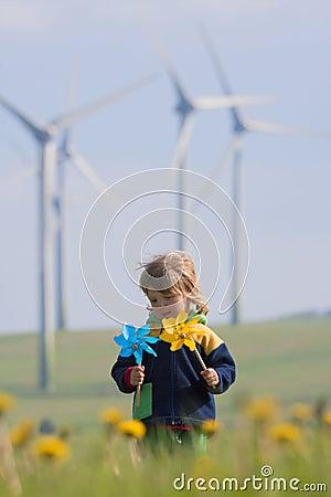 Free Boy With Pinwheel And Wind Farm Stock Image - 14460661