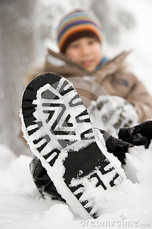 Free Boy With Snow On His Shoe Stock Photo - 62534570