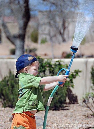 Free Boy With Water Hose Stock Images - 8431294