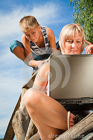 Boy and woman with laptop