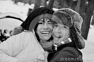 Boy and Woman Playing in the snow