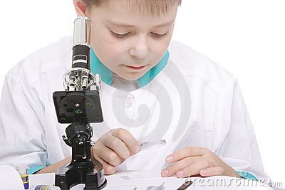 Boy working with magnifying glass