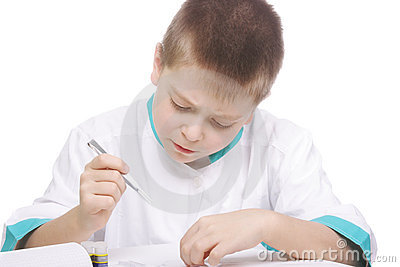 Boy working with tweezers