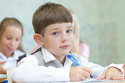 The boy writing