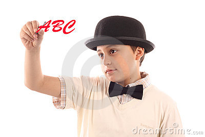 Boy writing alphabet Stock Photo