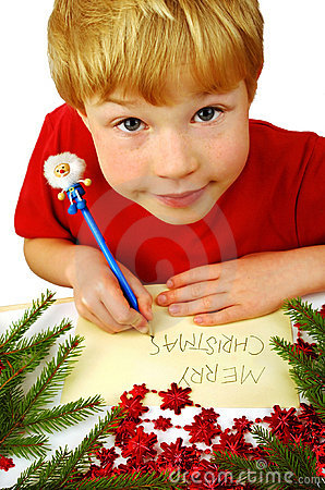 Boy writing Christmas wishes
