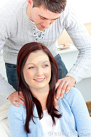 Boyfriend massaging his girlfriend s shoulders