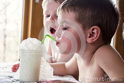 boys blowing milk bubbles
