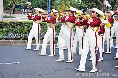 Boys blowing trumpet in marching band Editorial Image