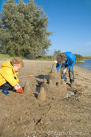 Boys Building Sandcastle