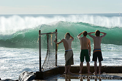 Boys Checking Out The Surf Editorial Stock Image