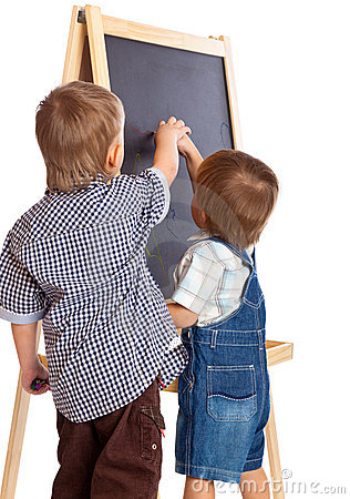 Boys are drawing on a blackboard