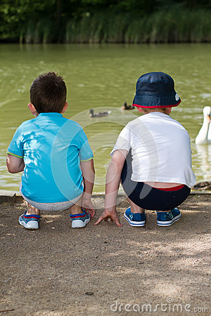 Boys at duck pond