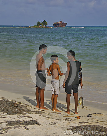 Boys with fish at San Andres beach, Colombia Editorial Photography
