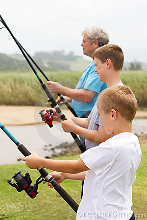 Boys fishing with grandpa