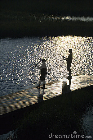 Free Boys Fishing On Dock. Stock Photography - 3417512