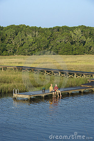 Free Boys Fishing On Dock. Stock Image - 3417521