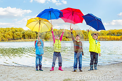 Boys and girls holding umbrellas