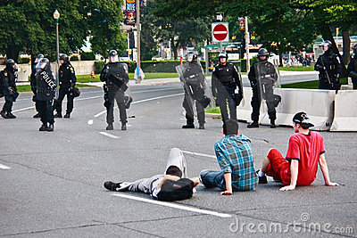 Boys infront of armed Police G8/G20 Protest Editorial Photo