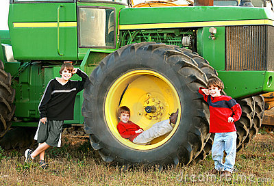 Boys and a Large Tractor Editorial Image