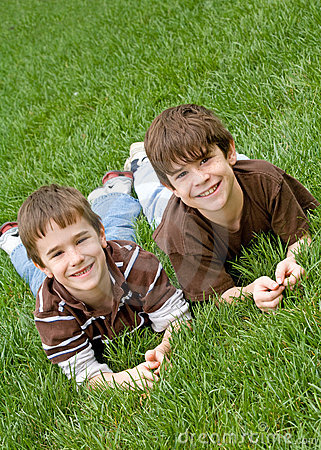 Free Boys Laying In Grass Stock Photo - 5165590