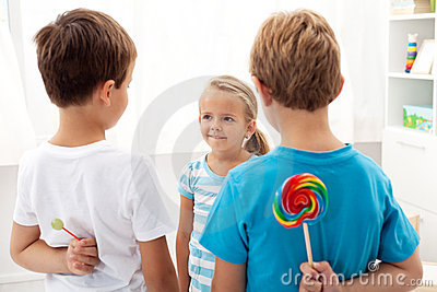 Boys with lollipops and a little girl