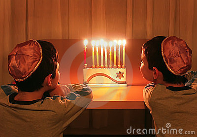 Boys Look at Hanukkah Menorah