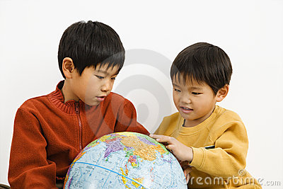 Boys looking at globe